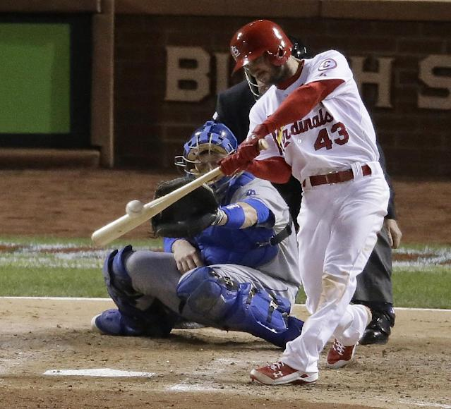 St. Louis Cardinals' Shane Robinson hits a two-run scoring single during the third inning of Game 6 of the National League baseball championship series against the Los Angeles Dodgers, Friday, Oct. 18, 2013, in St. Louis. (AP Photo/Chris Carlson)