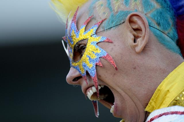 A Colombia soccer fan cheers for his team before the start of a 2014 World Cup qualifying soccer game against Uruguay in Montevideo, Uruguay, Tuesday, Sept. 10, 2013. (AP Photo/Matilde Campodonico)