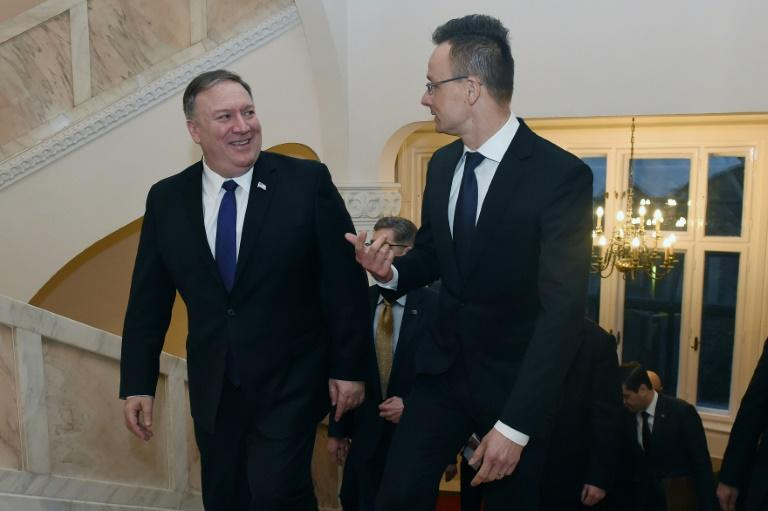 US Secretary of State Mike Pompeo (left) is welcomed in Budapest by Hungary's Foreign Minister Peter Szijjarto