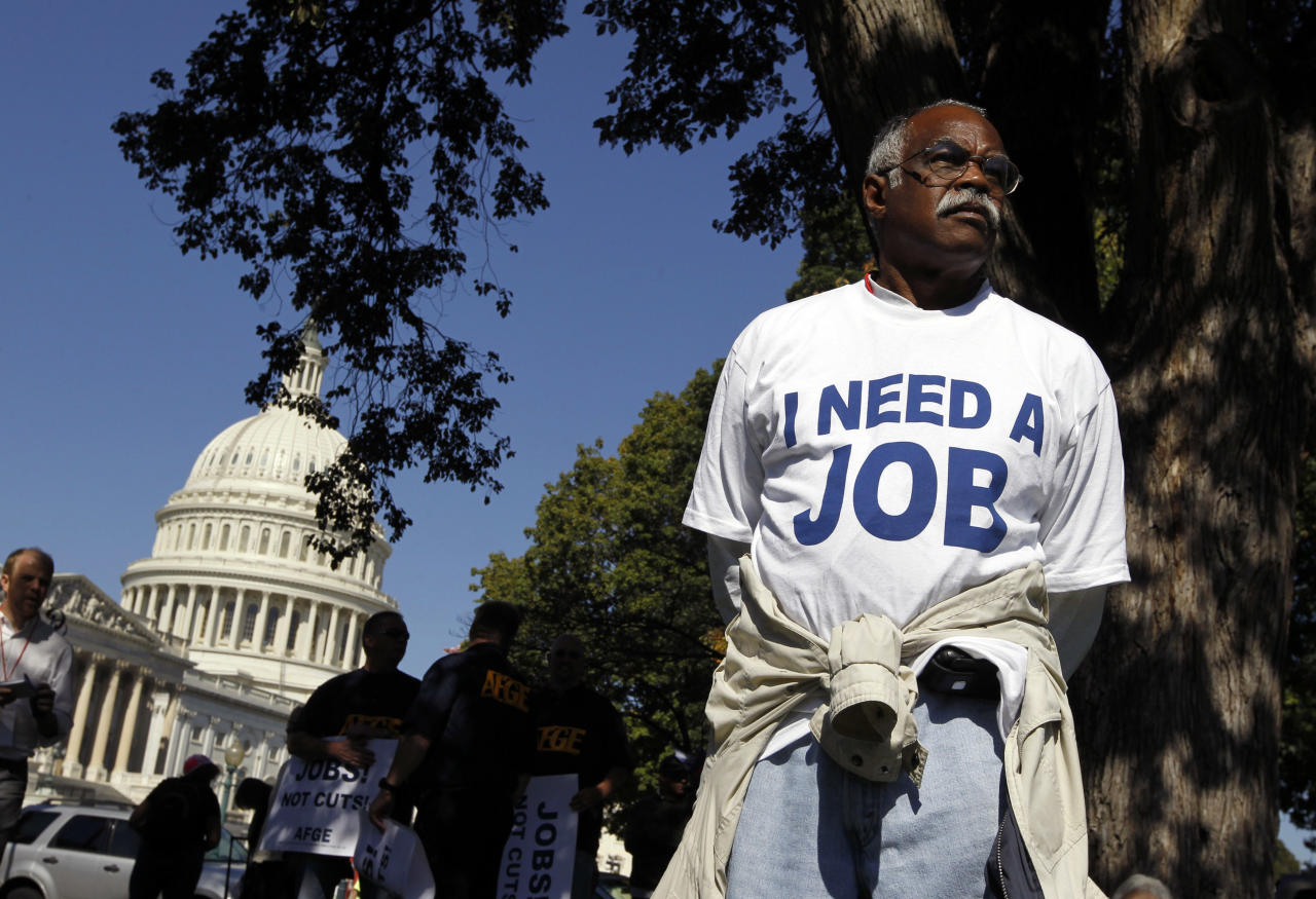 Mervin Sealy from Hickory, North Carolina, takes part in a protest rally outside the Capitol Building in Washington, October 5, 2011. Demonstrators were demanding that Congress create jobs, not make budget cuts during the protest.    REUTERS/Jason Reed   (UNITED STATES - Tags: POLITICS BUSINESS CIVIL UNREST)