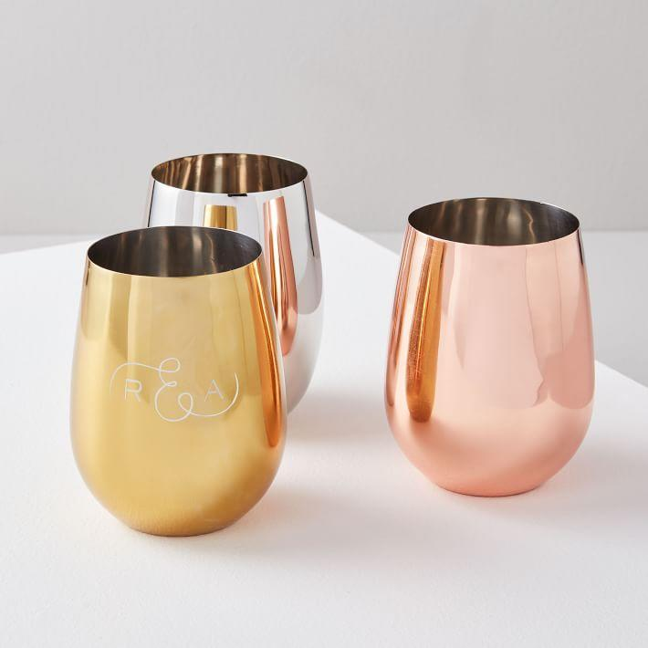"""<h2>West Elm Monogrammed Metal Stemless Wine Glasses</h2> <br>Not only can she sip her favorite vintage from a personalized gilded goblet that will keep it cool, but she can also do so wherever she pleases without fear of shattering the thing. <br><br><em>Shop <strong><a href=""""https://www.westelm.com/shop/dining-kitchen/wine-champagne-glasses/"""" rel=""""nofollow noopener"""" target=""""_blank"""" data-ylk=""""slk:West Elm"""" class=""""link rapid-noclick-resp"""">West Elm</a></strong></em><br><br><strong>West Elm</strong> Metal Stemless Wine Glasses, $, available at <a href=""""https://go.skimresources.com/?id=30283X879131&url=https%3A%2F%2Fwww.westelm.com%2Fproducts%2Fmetal-stemless-wine-glasses-e1984%2F"""" rel=""""nofollow noopener"""" target=""""_blank"""" data-ylk=""""slk:West Elm"""" class=""""link rapid-noclick-resp"""">West Elm</a><br><br><br>"""