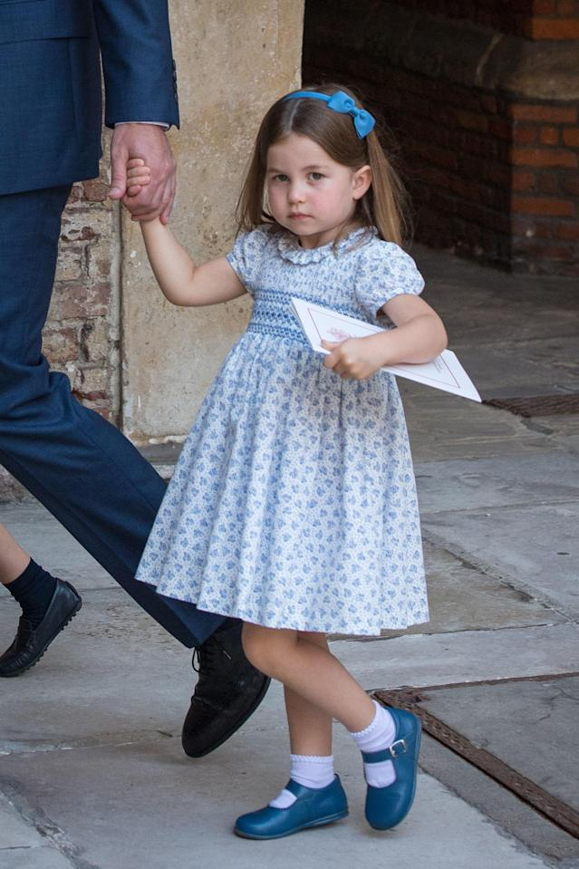 Princess Charlotte wore a blue smock dress and matching bow headband. (Photo: Getty Images)