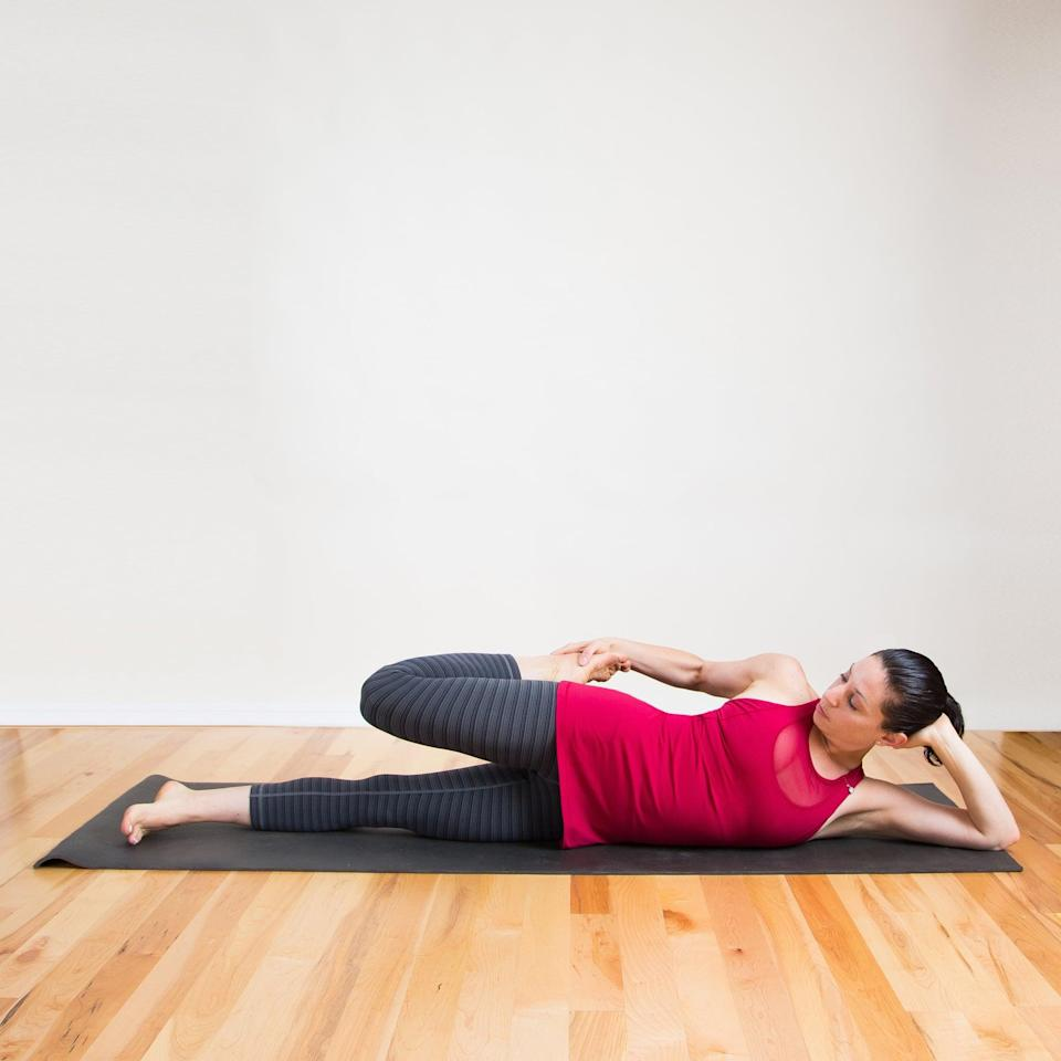 <ul> <li>Lie down on one side and prop your head up with your hand. Pull your foot toward your butt, and bend your bottom knee if you're having trouble staying steady.</li> <li>Hold for 30 seconds, then switch sides.</li> </ul>