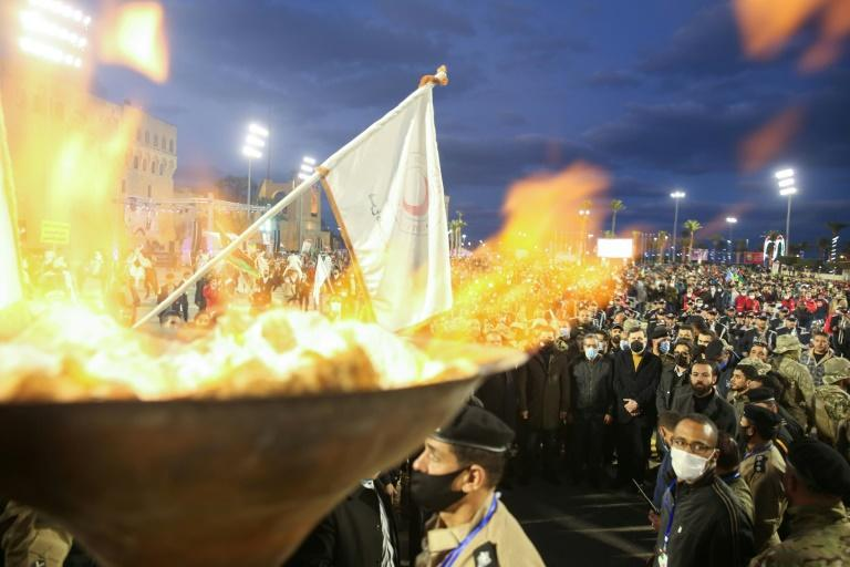 Libyans lit a commemorative torch in Martyrs' Square on Tuesday night in early celebrations