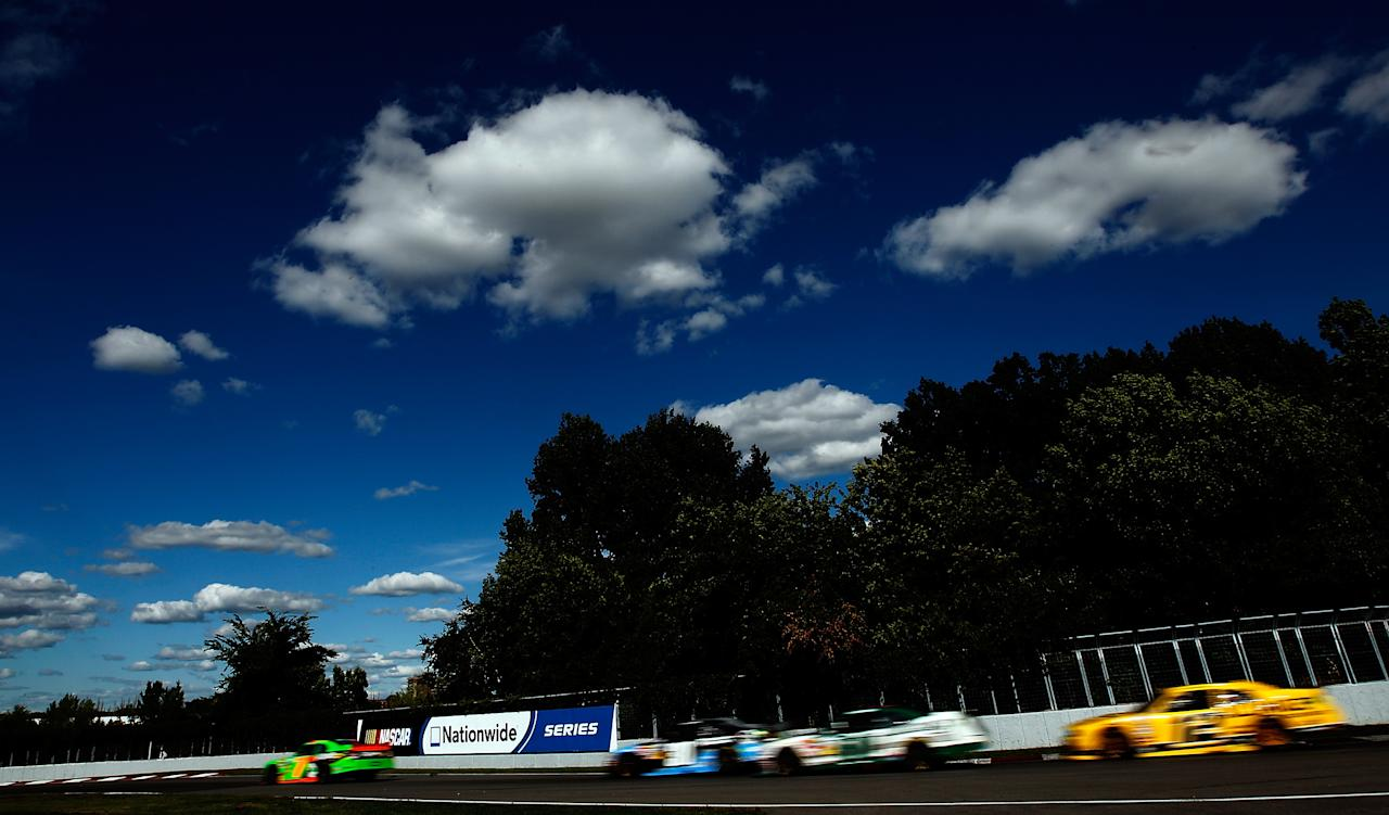 MONTREAL, QC - AUGUST 18:  Danica Patrick, driver of the #7 GoDaddy.com Chevrolet, leads the field during the NASCAR Nationwide Series sixth annual NAPA AUTO PARTS 200 presented by Dodge at Circuit Gilles Villeneuve on August 18, 2012 in Montreal, Quebec, Canada.  (Photo by Tom Pennington/Getty Images for NASCAR)
