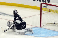 Los Angeles Kings goaltender Calvin Petersen gives up a goal on a shot from St. Louis Blues' David Perron during the first period of an NHL hockey game Friday, March 5, 2021, in Los Angeles. (AP Photo/Marcio Jose Sanchez)