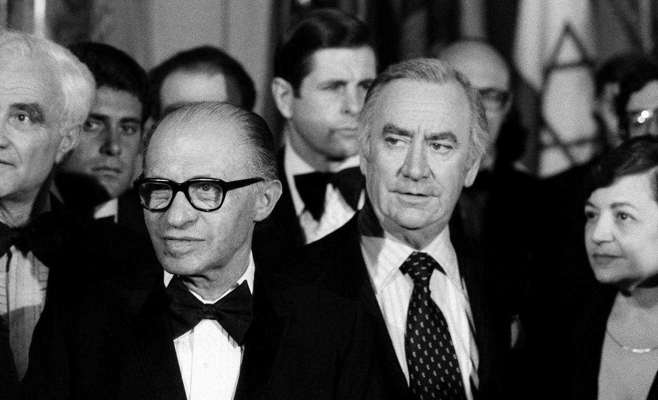 FILE - In this May 4, 1978 file photo, Israeli Prime Minister Menachem Begin, center left, and New York Gov. Hugh Carey, center right, attend a reception at New York's Waldorf Astoria Hotel, held to mark the 30th anniversary of the State of Israel. Carey, who led the rescue effort that brought New York City back from the brink of bankruptcy during its 1975 fiscal crisis, died Sunday, Aug. 7, 2011. He was 92. (AP Photo/Ray Stubblebine, File)