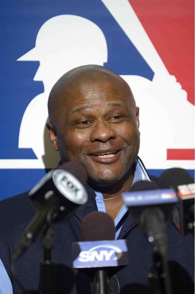 Seattle Mariners manager Lloyd McClendon answers a question from reporters during a media availability at baseball's winter meetings in Lake Buena Vista, Fla., Tuesday, Dec. 10, 2013.(AP Photo/Phelan M. Ebenhack)