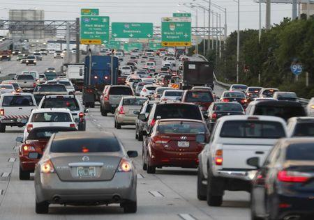 Rush hour traffic is shown on Interstate 95 near downtown Miami, Florida November 5, 2015. Nearly two-thirds of Americans would support roadway user fees to help fix the country's crumbling transportation infrastructure, according to a survey to be published on April 28, 2016 that was seen by Reuters.   REUTERS/Joe Skipper/File Photo