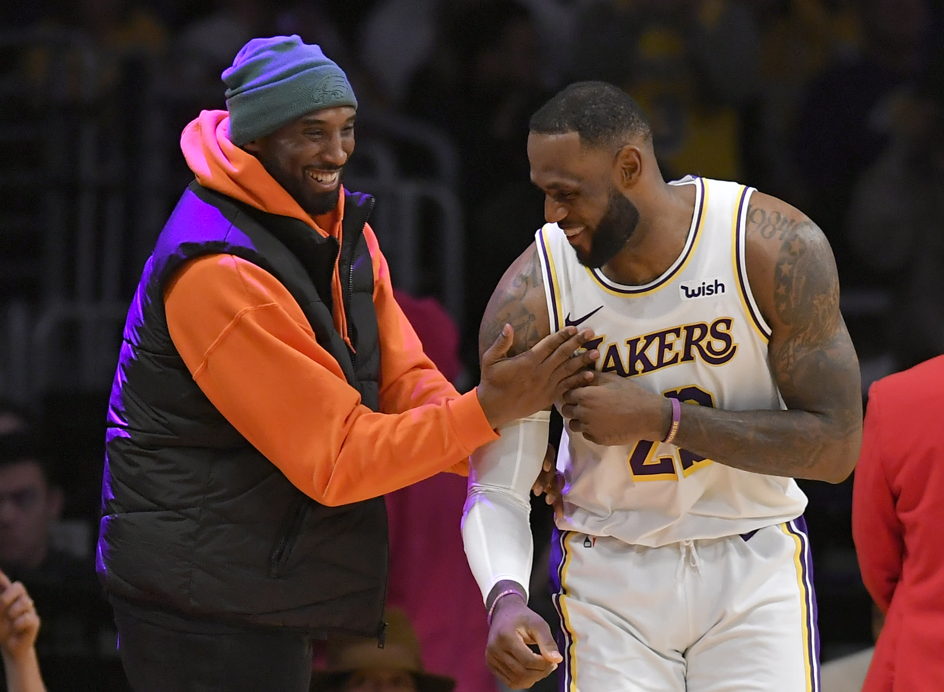 LOS ANGELES, CA - DECEMBER 29: LeBron James #23 of the Los Angeles Lakers has a moment on the sideline with former Laker Kobe Bryant in the second half during a game against the Dallas Mavericks at Staples Center on December 29, 2019 in Los Angeles, California. NOTE TO USER: User expressly acknowledges and agrees that, by downloading and/or using this photograph, user is consenting to the terms and conditions of the Getty Images License Agreement. (Photo by John McCoy/Getty Images)