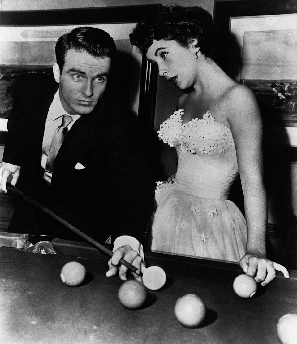 <p>Elizabeth Taylor was known for her glamorous style, and the characters she played on-screen were no exception. For her climatic scene in <em>A Place in the Sun </em>with Montgomery Clift, the starlet stole the show in a strapless tulle ball gown with floral appliqué. </p>