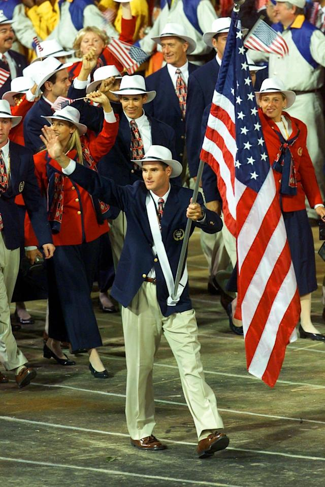 Cliff Meidl carries the U.S. flag as he leads the U.S. Olympic Team into Olympic Stadium during the opening ceremony of the Olympics Friday, Sept. 15, 2000 in Sydney. (AP Photo/Beth A. Keiser)