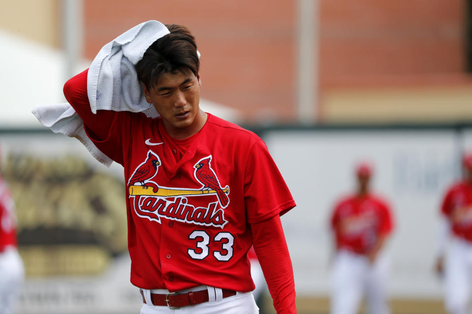 St. Louis Cardinals pitcher Kwang-Hyun Kim heads to the dugout after warming up before the start of a spring training baseball game against the Miami Marlins Wednesday, Feb. 26, 2020, in Jupiter, Fla. (AP Photo/Jeff Roberson)