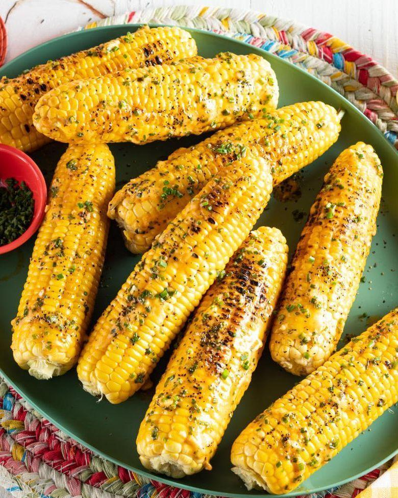 """<p>Upgrade corn by grilling them! These ears of corn are topped with garlic-chive butter and will quickly become a summer staple.</p><p><strong><a href=""""https://www.thepioneerwoman.com/food-cooking/recipes/a35939987/grilled-corn-on-the-cob/"""" rel=""""nofollow noopener"""" target=""""_blank"""" data-ylk=""""slk:Get the recipe"""" class=""""link rapid-noclick-resp"""">Get the recipe</a>.</strong></p><p><a class=""""link rapid-noclick-resp"""" href=""""https://go.redirectingat.com?id=74968X1596630&url=https%3A%2F%2Fwww.walmart.com%2Fbrowse%2Fhome%2Fserveware%2Fthe-pioneer-woman%2F4044_623679_639999_2347672&sref=https%3A%2F%2Fwww.thepioneerwoman.com%2Ffood-cooking%2Fmeals-menus%2Fg32188535%2Fbest-grilling-recipes%2F"""" rel=""""nofollow noopener"""" target=""""_blank"""" data-ylk=""""slk:SHOP SERVEWARE"""">SHOP SERVEWARE</a></p>"""