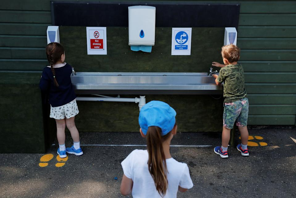 Children are seen washing their hands at Heath Mount School as some schools reopen, following the outbreak of the coronavirus disease (COVID-19), Watton-at-Stone, Britain, June 2, 2020. REUTERS/Andrew Couldridge