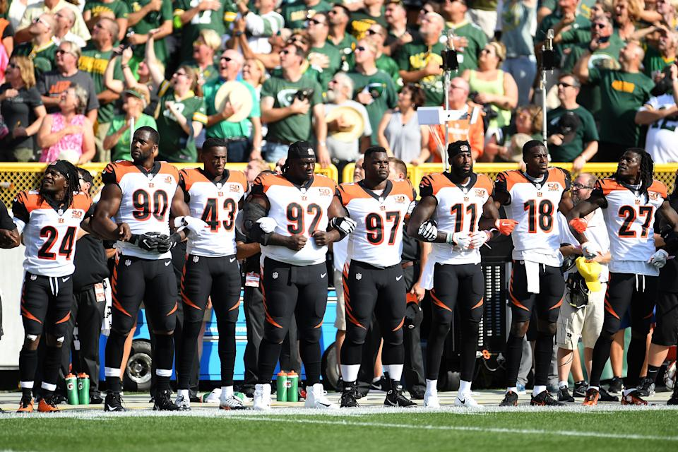 Members of the Cincinnati Bengals stand with arms locked as a sign of unity during the national anthem prior to their game against the Green Bay Packers at Lambeau Field on September 24, 2017. (Photo by Stacy Revere/Getty Images)