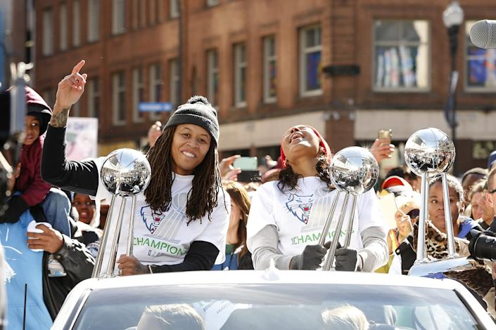 "Minnesota Lynx basketball players Seimone Augustus, left, and Maya Moore, right, react to fan cheers during a parade to celebrate the team's WNBA Championship on Oct. 16, 2015, in Minneapolis. <span class=""copyright"">(Stacy Bengs / Associated Press)</span>"