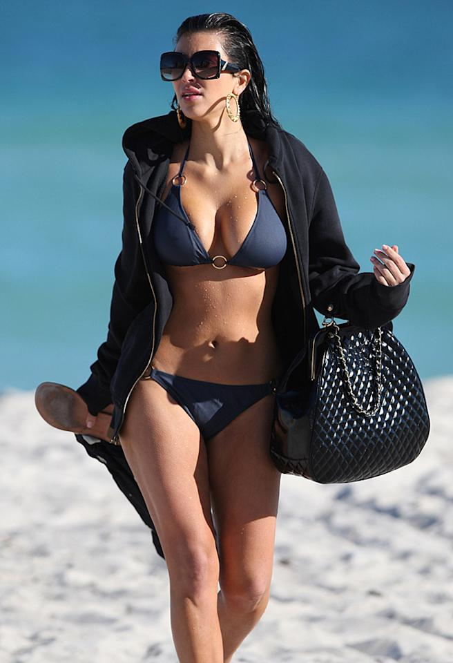 November 16, 2008: Kim Kardashian spotted playing at the beach in Miami, Florida.