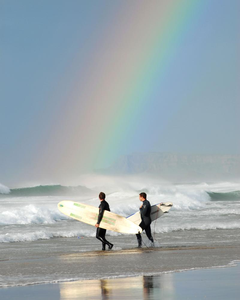 Surfers on the East Strand Portrush County Antrim Northern Ireland.