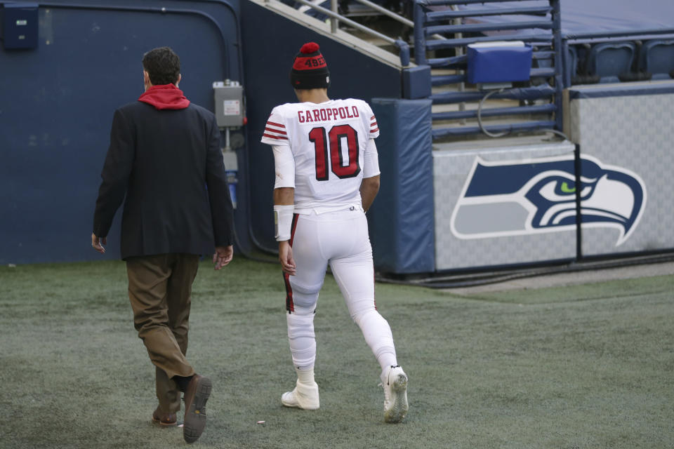 San Francisco 49ers quarterback Jimmy Garoppolo (10) walks to the locker room during the second half of an NFL football game against the Seattle Seahawks, Sunday, Nov. 1, 2020, in Seattle. (AP Photo/Scott Eklund)