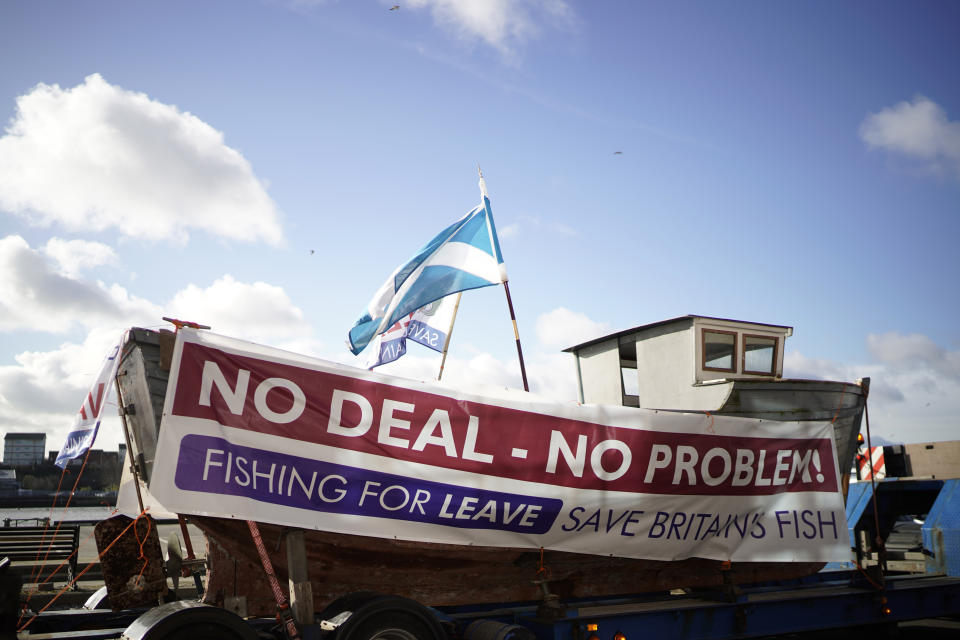 "NORTH SHIELDS, ENGLAND - MARCH 15: A boat with a ""No Deal No Problem"" sign attached to it on the quay side at North Shields as campaigners prepare for the Fishing For Leave flotilla on March 15, 2019 in North Shields, United Kingdom. Fishing for Leave are supporting other Pro-Brexit groups who are calling for the Government to scrap the Withdrawal Agreement and for MP's to ensure that Britain leaves the EU with no deal. The flotilla marks the official launch of the 'March to Leave' walk that begins the following day and will make its way to London in 14 stages arriving on March 29, the original date for the UK to leave the European Union.(Photo by Christopher Furlong/Getty Images)"