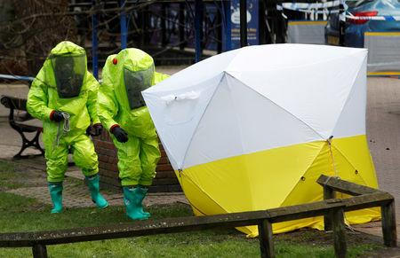 The forensic tent, covering the bench where Sergei Skripal and his daughter Yulia were found, is repositioned by officials in protective suits in the centre of Salisbury, Britain, March 8, 2018. REUTERS/Peter Nicholls     TPX IMAGES OF THE DAY