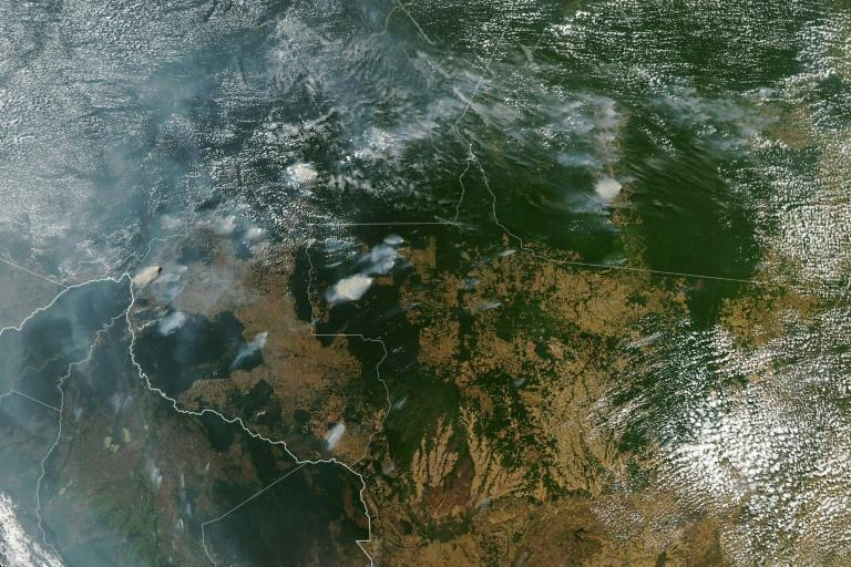 A NASA Earth Observatory image shows several fires burning in the Brazilian states of Amazonas (top C-L), Para (top R), Mato Grosso (bottom R) and Rondonia (bottom C) on August 11, 2019, while Bolivia appears bottom left (AFP Photo/HO)