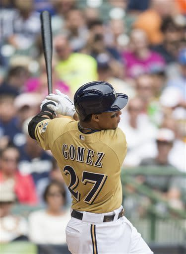 Milwaukee Brewers' Carlos Gomez connects for a two-run home run against the Philadelphia Phillies during the sixth inning of a baseball game on Sunday, June 9, 2013, in Milwaukee. (AP Photo/Tom Lynn)