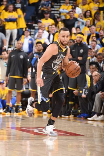OAKLAND, CA - May 1: Stephen Curry #30 of the Golden State Warriors handles the ball against the New Orleans Pelicans in Game Two of Round Two of the 2018 NBA Playoffs on May 1, 2018 at ORACLE Arena in Oakland, California. (Photo by Andrew D. Bernstein/NBAE via Getty Images)