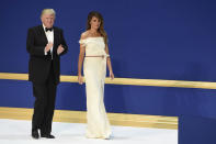 """<p>For the inaugural balls, the newly-minted first lady wore a white off-the-shoulder gown that she helped design with Hervé Pierre. According to Pierre himself, the FLOTUS was very involved in the process. """"Hervé, I love you, but I cannot move my arm to hold my husband's arm when we dance,"""" Pierre said of the pair's collaboration process, according to Bazaar.com. """"As a man designing for a woman, you put into the clothing your ideals, what you idolize, but a woman will put you back on track and say, 'I cannot reach my fork,'"""" he said. (Photo: Getty Images) </p>"""