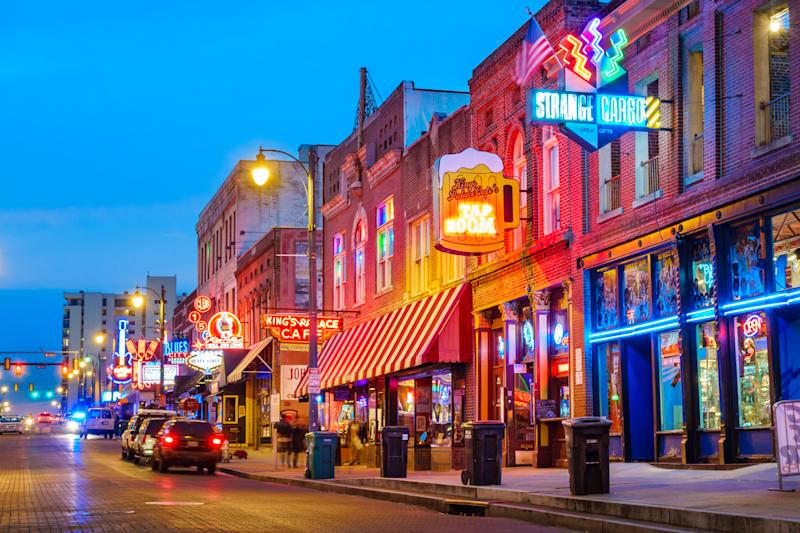 Photo of colorful cafe bars at the iconic Beale Street music and entertainment district of downtown Memphis, Tennessee, USA, illuminated at night.