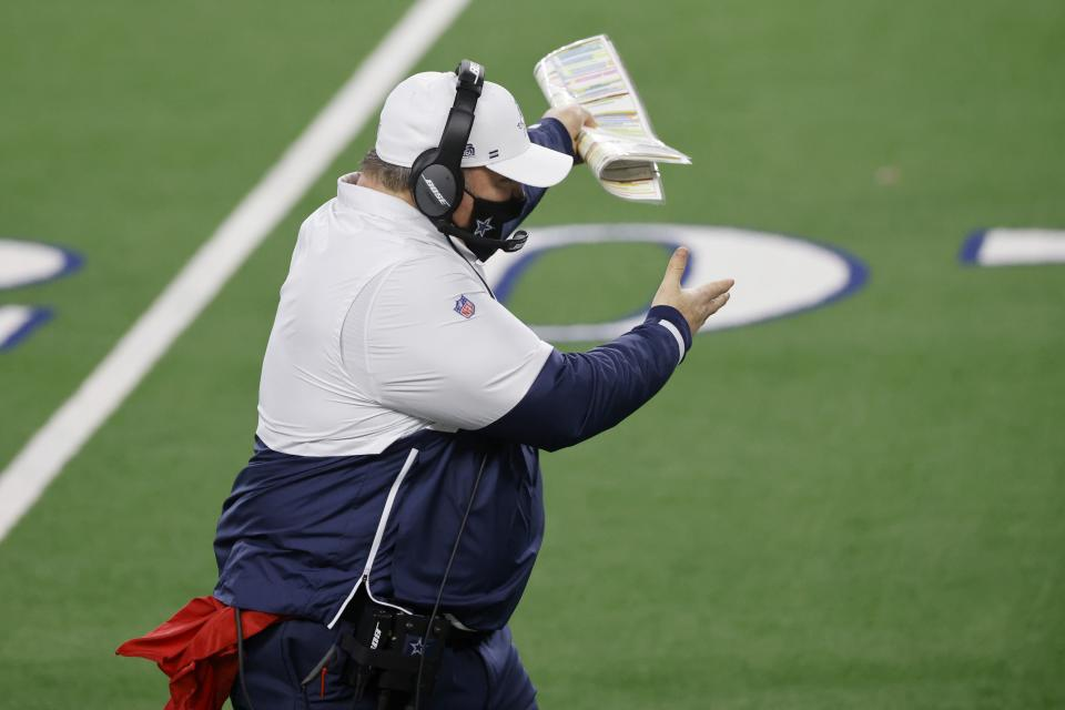 Dallas Cowboys coach Mike McCarthy gestures as he walks along the sideline in the second half of an NFL football game against the Washington Football Team in Arlington, Texas, Thursday, Nov. 26, 2020. (AP Photo/Ron Jenkins)