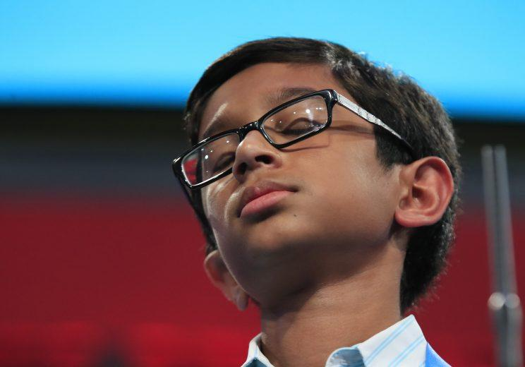 Rohan Rajeev reacts after misspelling a word during the finals of the 90th Scripps National Spelling Bee