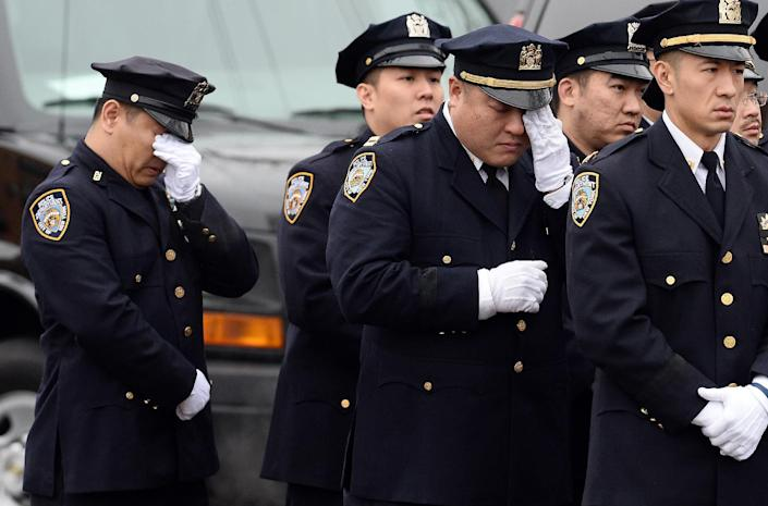 NYPD officers cry during the funeral of their fellow officer Wenjian Liu in Brooklyn on January 4, 2015 (AFP Photo/Jewel Samad)