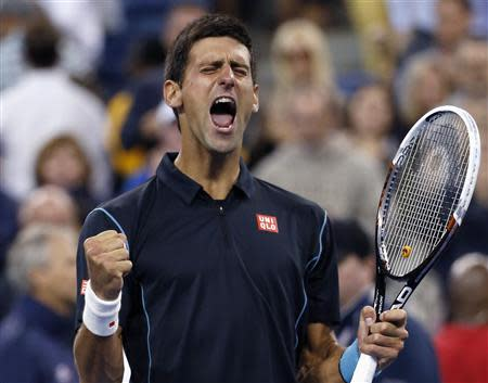 Novak Djokovic of Serbia celebrates defeating Mikhail Youzhny of Russia during their quarter-final match at the U.S. Open tennis championships in New York, September 5, 2013. REUTERS/Mike Segar