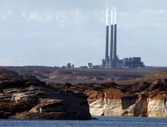 """FILE - In this Sept. 4, 2011 file photo shows the main plant facility at the Navajo Generating Station, from Lake Powell, in Page, Ariz. The United Nations climate chief is urging people not to look solely to their governments to make tough decisions to slow global warming, and instead to consider their own role in solving the problem. Approaching the half-way point of two-week climate talks in Doha, Christiana Figueres, the head of the U.N.'s climate change secretariat, said Friday, Nov. 30, 2012 that she didn't see """"much public interest, support, for governments to take on more ambitious and more courageous decisions.""""(AP Photo/Ross D. Franklin, File)"""