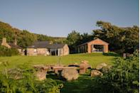 """<p>How does a private beach, acres of land and a welcome hamper on arrival (filled with local eggs, fresh bread, Welsh cakes and ethical coffee) sound to you?</p><p>Located alone the Welsh coastline, this haven is close to the pilgrim's route where you can walk, run or cycle and also features a BBQ and luscious green lawn in the garden where you can hunker down with burgers or marshmallows at the firepit at night.</p><p>We also can't get enough of this spot's modern cottage cream-coloured interiors and outdoor fairy lights. </p><p>You'll also have the choice of several places to stay, from the Dairy (four people), Barn (four people) and Cottage (six).</p><p><strong>Cottage for 14 from £285 <strong>per</strong> night</strong></p><p><a href=""""https://www.sawdays.co.uk/britain/wales/gwynedd/ty-coch/"""" rel=""""nofollow noopener"""" target=""""_blank"""" data-ylk=""""slk:BOOK ONLINE"""" class=""""link rapid-noclick-resp"""">BOOK ONLINE</a></p>"""