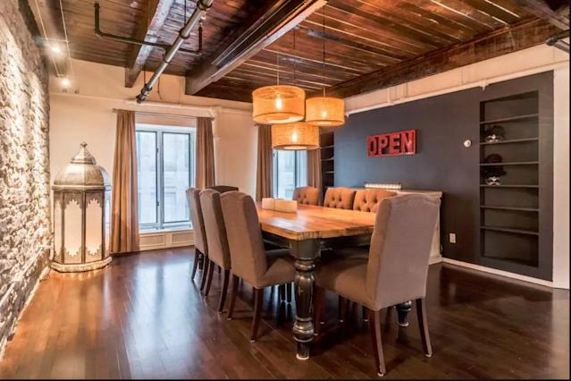 <p>The sleek contemporary furnishings include a well-appointed dining room. (Airbnb) </p>