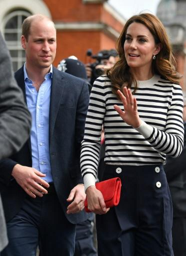 Prince William, seen here with his wife Catherine, Duchess of Cambridge on Tuesday, warned his younger brother Harry that 'the sleep deprivation society that is parenting' awaits him
