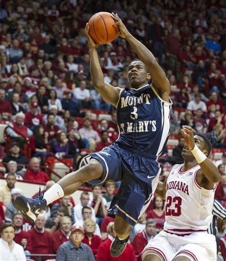 Mount St. Mary's Sam Prescott (3) shoots past Indiana's Remy Abell during the first half of an NCAA college basketball game, Wednesday, Dec. 19, 2012, in Bloomington, Ind. (AP Photo/Doug McSchooler)