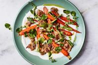 """If you feel like shaping perfect meatballs is kinda too fussy for a weeknight meal, we agree. That's why this recipe has you drop dollops of spiced ground chicken onto a sheet pan, where they'll roast with sweet carrots until everything is golden brown. <a href=""""https://www.epicurious.com/recipes/food/views/freeform-chicken-meatballs-with-carrots-and-yogurt-sauce?mbid=synd_yahoo_rss"""" rel=""""nofollow noopener"""" target=""""_blank"""" data-ylk=""""slk:See recipe."""" class=""""link rapid-noclick-resp"""">See recipe.</a>"""
