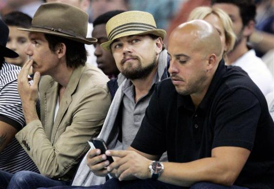 Leonardo DiCaprio sits court-side as the New Orleans Hornets take on the Los Angeles Lakers in New Orleans, April 9, 2012.