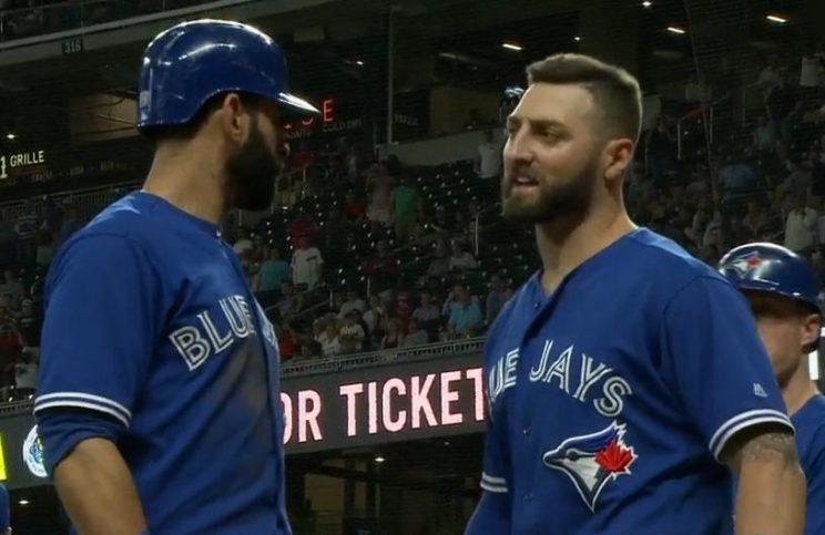 Kevin Pillar (right) is ushered back to the Blue Jays dugout by teammate Jose Bautista after a heated confrontation with Braves reliever Jason Motte. (MLB.TV)