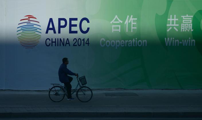 A man rides a bike outside the China National Convention Centre (CNCC) in Beijing on November 9, 2014, where the Asia-Pacific Economic Cooperation (APEC) Summit is being held (AFP Photo/Wang Zhao)