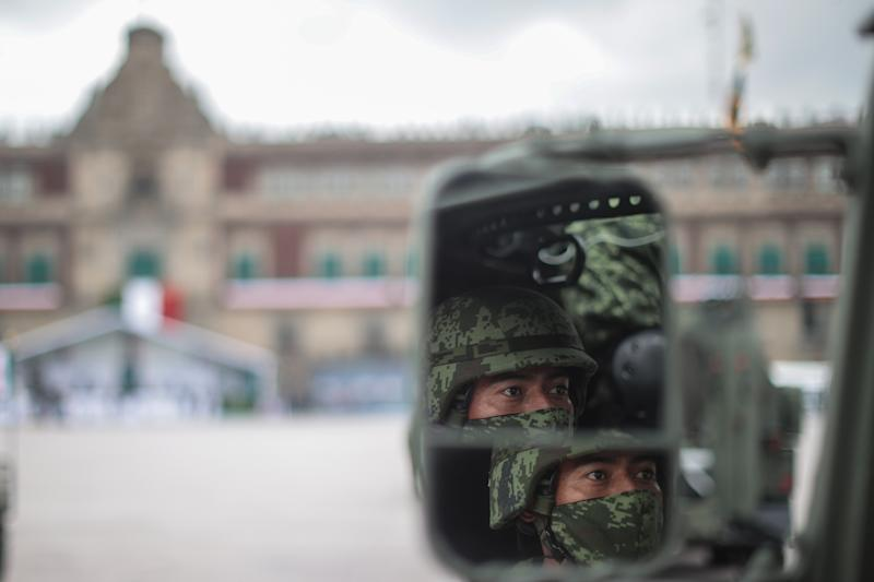 VARIOUS CITIES, MEXICO - SEPTEMBER 16: Mexican soldier looks on during the Independence Day military parade at Zocalo Square on September 16, 2020 in Various Cities, Mexico. This year El Zocalo remains closed for general public due to coronavirus restrictions. Every September 16 Mexico celebrates the beginning of the revolution uprising of 1810. (Photo by Hector Vivas/Getty Images)