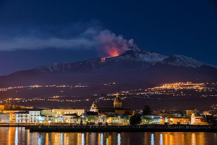 <p>Mount Etna, Europe's most active volcano, spews lava with the Sicilian town of Riposto, Italy, visible in foreground, during an eruption in the early hours of Tuesday, April 11, 2017. (AP Photo/Salvatore Allegra) </p>