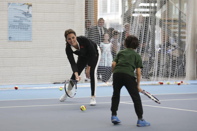 Despite being pregnant, Kate Middleton played some tennis with the U.K.'s top young talent. (Photo: PA)