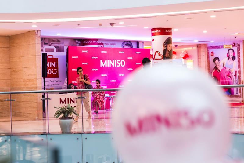 (Bloomberg) -- MINISO Co., a Chinese budget household and consumer good retailer, is planning an initial public offering that could raise about $1 billion, according to people with knowledge of the matter.The company is inviting banks to pitch for roles on the proposed offering, the people said, asking not to be identified because the information is private. The share sale could take place in Hong Kong or the U.S., while the timeline is yet to be decided, the people said.MINISO, founded by Japanese designer Miyake Junya and Chinese entrepreneur Ye Guofu in 2013, designs its products in Japan and has more than 3,500 stores across 80 countries including China, the U.S., Brazil, the United Arab Emirates and Russia, according to its website. The firm posted a revenue of 17 billion yuan ($2.5 billion) in 2018.Tencent Holdings Ltd. and Hillhouse Capital invested 1 billion yuan in the retailer last year in its first external financing round, according to a statement at the time.Deliberations are at an early stage, and details of the offering including the fundraising size could change, the people said. The company doesn't have any additional information to disclose after announcing in January last year that it plans an IPO, a representative said in an emailed response to Bloomberg.MINISO has been compared with Muji, the minimalist retailer owned by Ryohin Keikaku Co. which offers no-brand, no-logo lifestyle and household goods. In 2016, MINISO and a connected firm were ordered to compensate LVMH for its economic losses in a design infringement lawsuit in Shenzhen, according to a court document. On the other hand, the Chinese company is involved in several copyright disputes in which it accused other domestic retailers of copying its brand and fraud during marketing campaigns.(Updates to add an infringement case in last paragraph.)To contact the reporters on this story: Crystal Tse in Hong Kong at ctse44@bloomberg.net;Vinicy Chan in Hong Kong at vchan91@bloomberg.netTo contact the editors responsible for this story: Fion Li at fli59@bloomberg.net, Sam NagarajanFor more articles like this, please visit us at bloomberg.com©2019 Bloomberg L.P.
