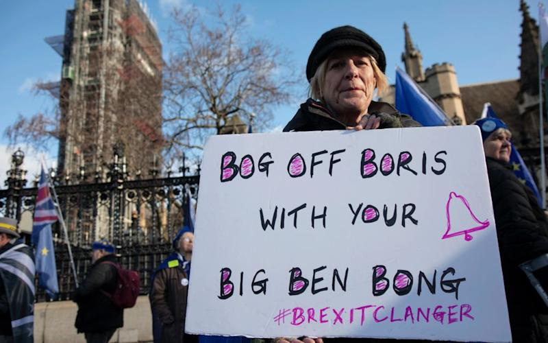 Anti Brexit protester with a placard reading 'Bog off Boris with your Big Ben bong' as a protest of the plan to potentially let Big Ben chime at midnight on January 31st. | Getty Images