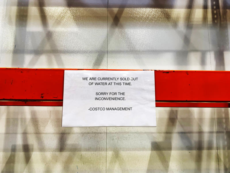 Empty shelves are seen with a sign at Costco stating that the retailer is currently sold out of water ahead of Hurricane Dorian on Aug. 29, 2019, in Davie, Fla. (Photo: Brynn Anderson/AP)